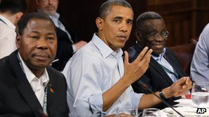 US President Barack Obama sits with Ghana President John Atta Mills, right, and President Yayi Boni of Benin during a luncheon on food security at the G8 Summit in May 2012
