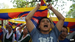 A man joins others in voicing opposition to Chinese government intervention in Tibet during a protest in New Delhi