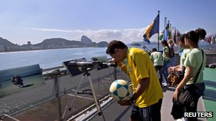Man peers through telescope in Rio de Janeiro