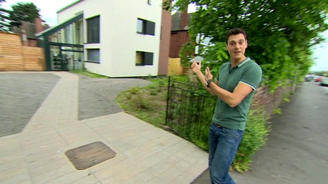Joe outside an eco-home