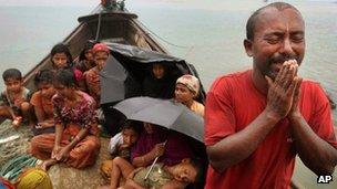 A Rohingya Muslim man who fled Burma to Bangladesh pleads with Bangladeshi border authorities in Taknaf, Bangladesh June 12