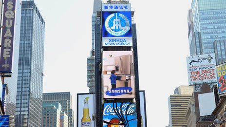 A new electronic billboard leased by Xinhua (2nd from top), the news agency operated by the Chinese government, makes its debut August 1, 2011 in New York&#039;s Times Square. 