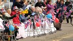 Elderly residents wave flags in Milton Bridge, 14 June 2012