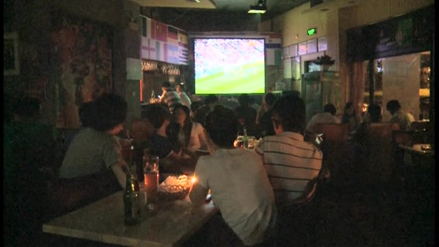 Chinese fans watch Euro 2012 at a bar