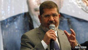 Egyptian presidential candidate Mohamed Mursi talks during a conference on tourism, in Cairo June 14, 2012