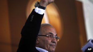 Egyptian presidential candidate Ahmed Shafiq addresses his supporters during an election rally in Cairo, Egypt, Thursday, June 14, 2012