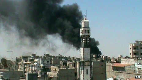 Image posted online by opposition activists purportedly showing smoke rising from the Khaldiya district of Homs (15 June 2012)