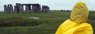 Yellow cagoule-clad sightseer at Stonehenge