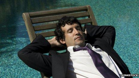 Man sunbathing in a suit