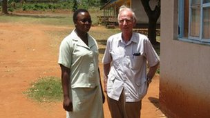 Dr Ian Bradley with a medial worker in Tanzania