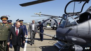 Russia&#039;s President Vladimir Putin (2nd L) looks at Mi-24 ground-attack helicopters as he visits a military airbase in the city of Korenovsk June 14, 2012