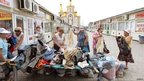 People choose second-hand clothes at a market in Donetsk, Ukraine, June 15, 2012
