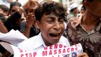 An ethnic Burmese Muslim cries during a protest outside Burma's embassy in Kuala Lumpur, Malaysia, on June 15, 2012.