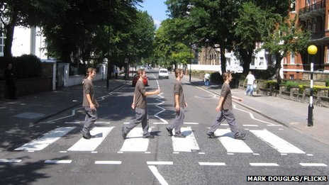 Man walking across Abbey Road