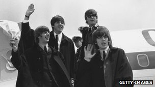 The Beatles return from a tour of Australia
