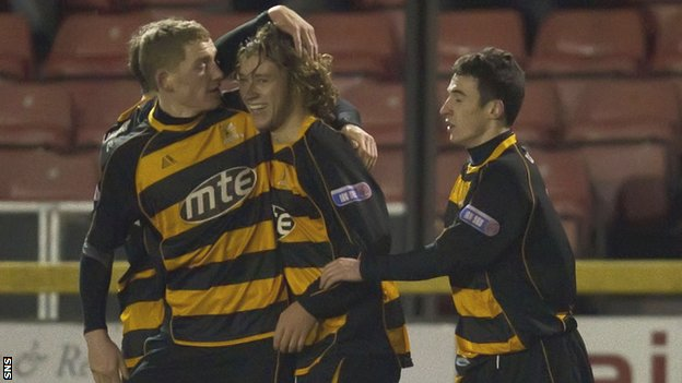 May (centre) celebrates scoring a goal while on loan with Alloa