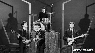 The Beatles singing in concert