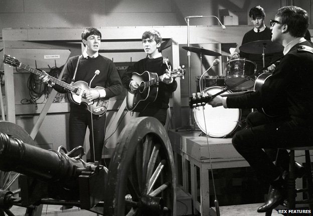 The Beatles performing in 1962 for their first studio recording in Manchester