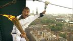 Bear Grylls zip-wires with Olympic flame off Tyne Bridge in Newcastle, 15 June 2012