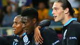 Ashley Young (left) and Andy Carroll (right) celebrate with Danny Welbeck (centre) after the third England goal