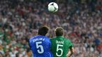 Irish defender Richard Dunne vies with Croatian defender Vedran Corluka during the Euro 2012 championships football match Republic of Ireland v Croatia at the Municipal Stadium in Poznan