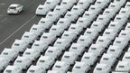 Audi and Volkswagen cars destined for export stand in Emden port, Germany