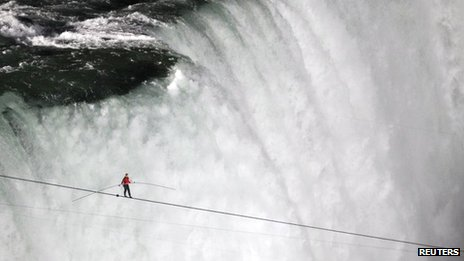 Tightrope walker Nik Wallenda walks the high wire from the US side to the Canadian side over the Horseshoe Falls in Niagara Falls, Ontario, 15 June 2012