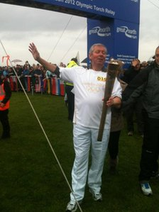 Brendan Foster with the Olympic torch