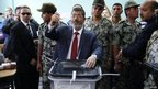Presidential candidate Mohamed Morsy of the Muslim Brotherhood casts his vote at a polling station in a school in Al-Sharqiya