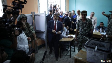 Presidential candidate Mohammed Mursi of the Muslim Brotherhood casts his vote at a polling station