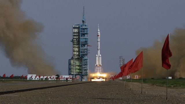 The Long March II-F rocket loaded with Shenzhou-9 manned spacecraft carrying Chinese astronauts Jing Haipeng, Liu Wang and Liu Yang lifts off from the launch pad in the Jiuquan Satellite Launch Center