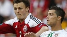 Denmark's William Kvist and Portugal's Cristiano Ronaldo