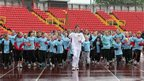 Jon Mellish carrying the Olympic Flame around Gateshead International Stadium, 16 June 2012