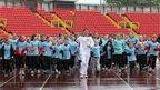 Jon Mellish carrying the Olympic Flame around Gateshead International Stadium, 16 June 2012
