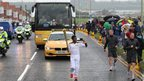 Haile Gebrselassie carries the torch in South Shields, 16 June 2012