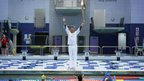 Steve Cram holding the Olympic flame in Sunderland&#039;s Aquatic Centre, 16 June 2012