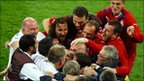 Head Coach Michal Bilek of Czech Republic is mobbed by players and staff at the final whistle