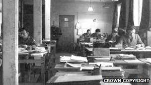 Wartime photograph of cryptanalysts working at Bletchley Park