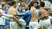 Greece celebrate after beating Russia
