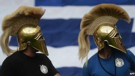 Greek football fans in helmets, Warsaw (16 June)