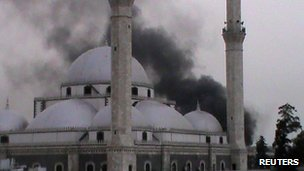 A handout image released by the Syrian opposition's Shaam News Network on June 16, 2012 allegedly shows smoke rising from a mosque in Homs