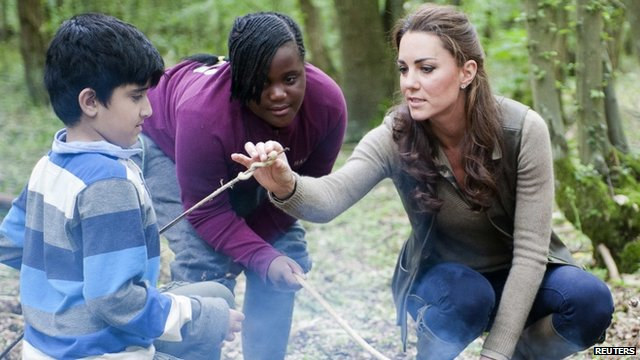 Duchess of Cambridge speaks to young people during a visit to the &quot;Expanding Horizons&quot; Primary School Project
