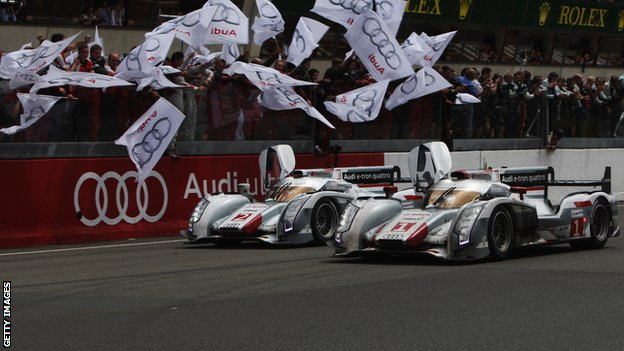 The two Audo e-tron Quattro hybrids are greeted by their fans after finishing first and second