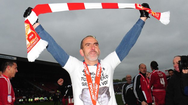 Swindon manager Paolo Di Canio celebrates winning the League Two title