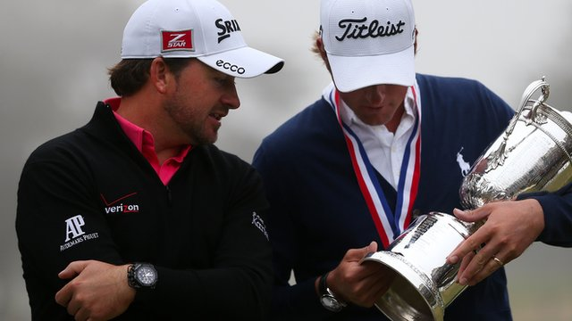 Graeme McDowell and Webb Simpson look at the US Open trophy