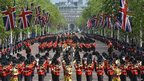 Military bands and Foot Guards march along The Mall
