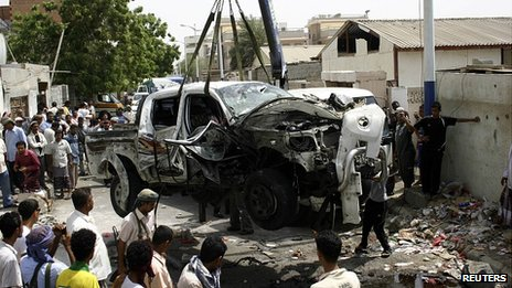 Wreck of car after suicide attack in Aden