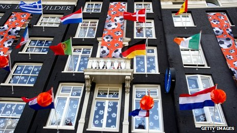 Flags flying from flats in Amsterdam