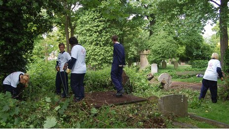 Volunteers carrying out maintenance work at a cemetery in Great Yarmouth