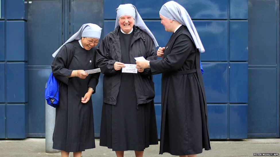 Catholic nuns laughing